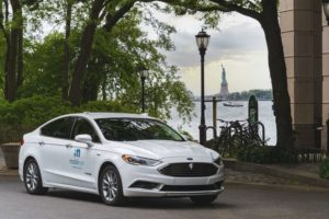 A_self-driving_vehicle_from_Mobileye's_autonomous_test_fleet_sits_parked_across_from_the_Statue_of_Liberty_in_June_2021._Mobileye_tests_its_technology_in_complex_urban_areas_in_preparation_for_future_driverless_services._(Credit:_Mobileye,_an_Intel_Compan