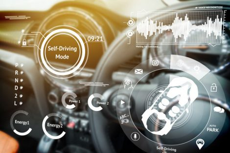 Smart_car_(HUD)_concept._Empty_cockpit_in_vehicle_and_Self-Driving_mode_car_graphic_screen_with_flare_light