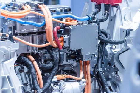 Chassis_of_the_electric_car_with_powertrain_and_power_connections_closeup.